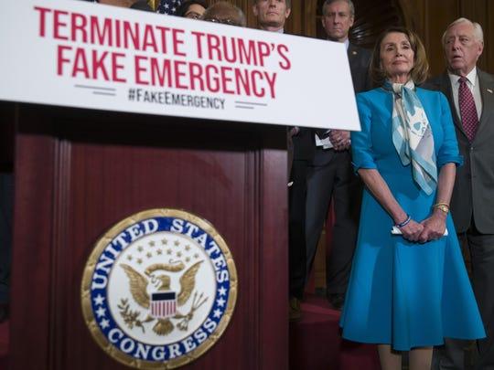 House Speaker Nancy Pelosi of Calif., left, stands