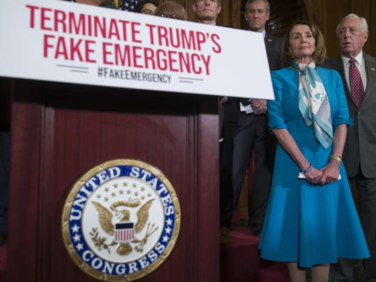 House Speaker Nancy Pelosi of Calif., left, stands with House Majority Leader Steny Hoyer of Md., and others, listens to a speaker about a resolution to block President Donald Trump's emergency border security declaration on Capitol Hill, Monday, Feb. 25, 2019 in Washington. House Democrats have introduced a resolution to block the national emergency declaration that President Donald Trump issued last week to fund his long-sought wall along the U.S-Mexico border, setting up a fight that could result in Trump's first-ever veto. (AP Photo/Alex Brandon)