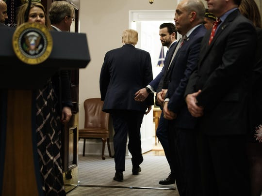 "President Donald Trump departs after a signing ceremony for an executive order on a ""National Roadmap to Empower Veterans and End Veteran Suicide,"" in the Roosevelt Room of the White House, Tuesday, March 5, 2019, in Washington. (AP Photo/ Evan Vucci)"