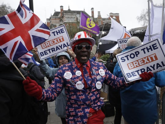 """Pro-Brexit leave the European Union supporters take part in a protest outside the Houses of Parliament in London, March 12, 2019. British Prime Minister Theresa May faced continued opposition to her European Union divorce deal Tuesday despite announcing what she described as """"legally binding"""" changes in hopes of winning parliamentary support for the agreement."""