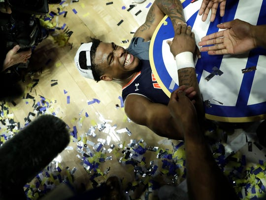 Auburn's Malik Dunbar celebrates after defeating Tennessee in the championship game of the NCAA Southeastern Conference basketball tournament Sunday, March 17, 2019, in Nashville, Tenn. Auburn won 84-64. (AP Photo/Mark Humphrey)
