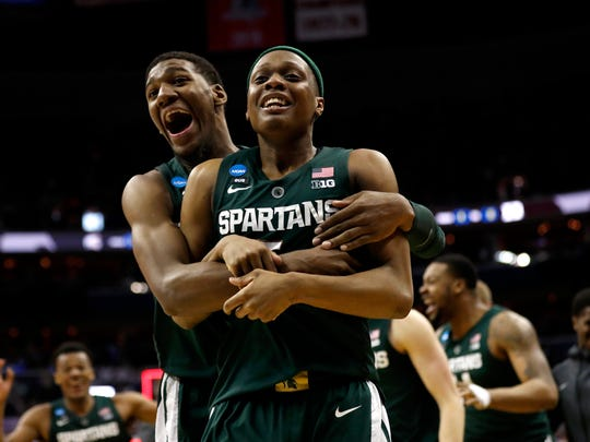 Michigan State guard Cassius Winston, right, and forward Aaron Henry celebrate after an NCAA men's East Regional final college basketball game against Duke, Sunday, March 31, 2019, in Washington. (AP Photo/Patrick Semansky)