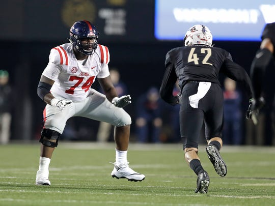 Mississippi offensive lineman Greg Little (74) plays against Vanderbilt linebacker Kenny Hebert (42) in the second half of an NCAA college football game Saturday, Nov. 17, 2018, in Nashville, Tenn. (AP Photo/Mark Humphrey)