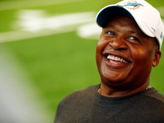 Miami Dolphins assistant head coach Jim Caldwell laughs during NFL rookie camp on Thursday, May 9, 2019, in Davie, Fla. (AP Photo/Brynn Anderson)