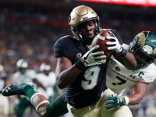 Colorado tight end Jalen Harris (9) pulls in a pass for a touchdown as Colorado State safety Jamal Hicks covers in the first quarter of an NCAA college football game Friday, Aug. 30, 2019, in Denver. (AP Photo/David Zalubowski)