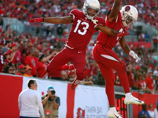 Nov 10, 2019; Tampa, FL, USA; Arizona Cardinals wide receiver Christian Kirk (13) is congratulated by running back Kenyan Drake (41) as he scores a touchdown  against the Tampa Bay Buccaneers during the second half at Raymond James Stadium. Mandatory Credit: Kim Klement-USA TODAY Sports