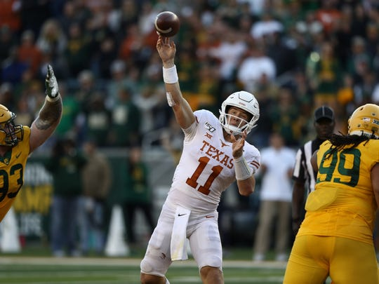 WACO, TEXAS - NOVEMBER 23:  Sam Ehlinger #11 of the Texas Longhorns throws against the Baylor Bears in the second half at McLane Stadium on November 23, 2019 in Waco, Texas. (Photo by Ronald Martinez/Getty Images)