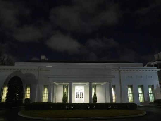 All the lights are on in the windows of the West Wing of the White House after news of a missile attack on an Iraqi air base housing U.S. troops, Tuesday, Jan. 7, 2020, in Washington. (AP Photo/Alex Brandon)