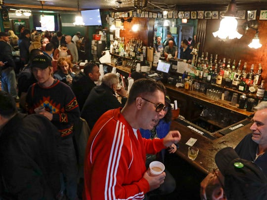 Patrons gather at Neir's Tavern on Saturday in New York's Queens borough.