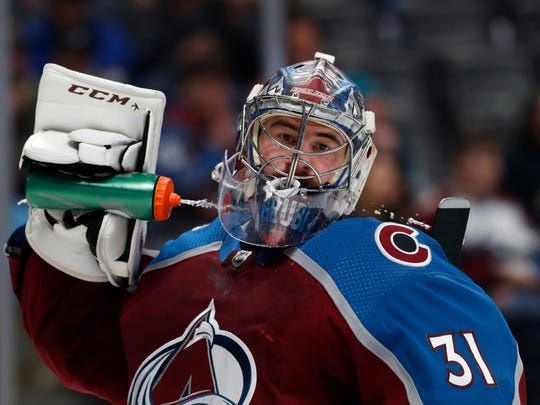 Colorado Avalanche goaltender Philipp Grubauer cools down during a timeout in the second period of the team's NHL hockey game against the San Jose Sharks on Thursday, Jan. 16, 2020, in Denver. (AP Photo/David Zalubowski)