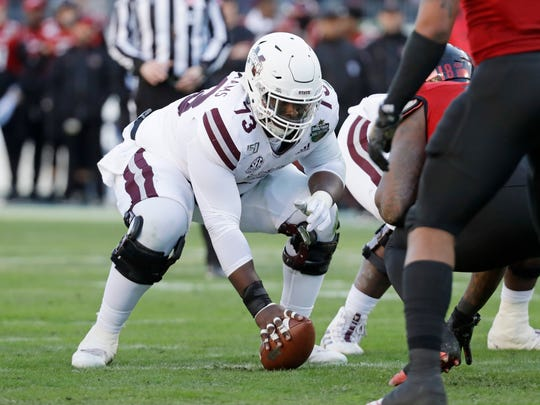 Mississippi State center Darryl Williams (73) plays against Louisville in the first half of the Music City Bowl NCAA college football game Monday, Dec. 30, 2019, in Nashville, Tenn. (AP Photo/Mark Humphrey)