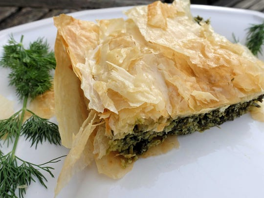 Spanakopita, or Greek spinach pie, is a savory dish made with herbs, feta and delicate phyllo dough.