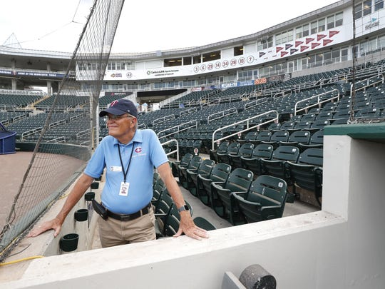 Hammond Stadium usher Ken Trammell looks out on an empty stadium on March 12 in Fort Myers. [Elise Amendola/The Associated Press]