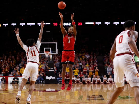 AMES, IA - FEBRUARY 22: Jahmi'us Ramsey #3 of the Texas Tech Red Raiders takes a three point shot as Prentiss Nixon #11 of the Iowa State Cyclones blocks in the first half of the play at Hilton Coliseum on February 22, 2020 in Ames, Iowa. (Photo by David Purdy/Getty Images)