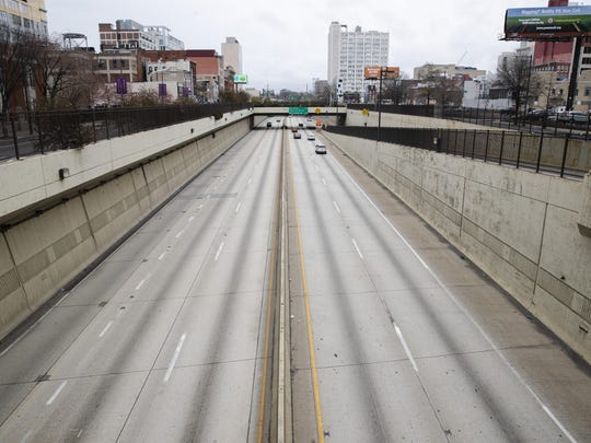 Few people travel on Interstate 676 in Philadelphia, Wednesday, March 25, 2020. Philadelphia Mayor Jim Kenney is issuing a stay-at-home order to the nation's sixth most-populated city to keep its 1.6 million people from leaving home, due to the coronavirus except to get food, seek medical attention, exercise outdoors, go to a job classified as essential or other errands that involve personal and public safety. (AP Photo/Matt Rourke)