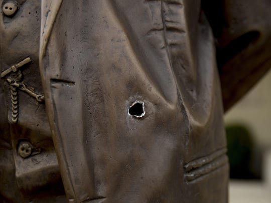 A bullet hole is visible in the statue of Cuban independence hero José Martí outside the Cuban Embassy in Washington May 1 after a man opened fire with an assault rifle on Thursday morning. Officers found the suspect with an assault rifle and took the person into custody without incident, police said.