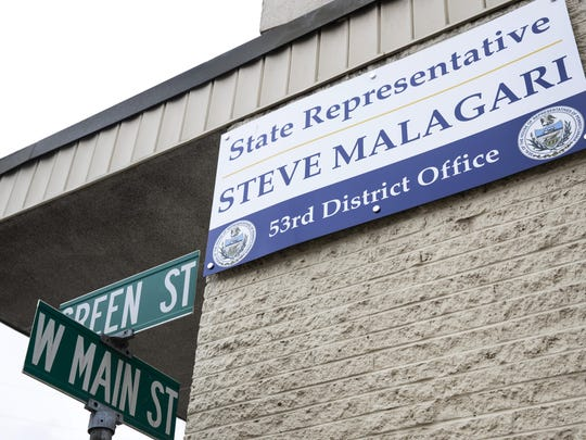 """In this April 27, 2020, photo is one of several signs made for Rep. Steve Malagari, posted outside his district office in Lansdale, Pa. The Legislature spent more than $50,000 on signs in 2018-19. The costs varied widely, as did the type of sign. Malagari, a Democrat from Lansdale, hired a sign business on his block to fabricate a main exterior sign, a brushed aluminum """"suite marker,"""" a vinyl sign for the front window and a 2-foot-by-3-foot sandwich board to catch pedestrians. The cost was nearly $1,300. Many of the newly purchased signs were for freshmen like Malagari, but some of last year's sign purchases were by veteran lawmakers. (AP Photo/Matt Rourke)"""