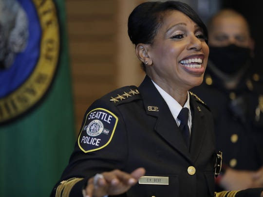 Seattle Police Chief Carmen Best laughs for a light moment at a press conference in Seattle on Tuesday.