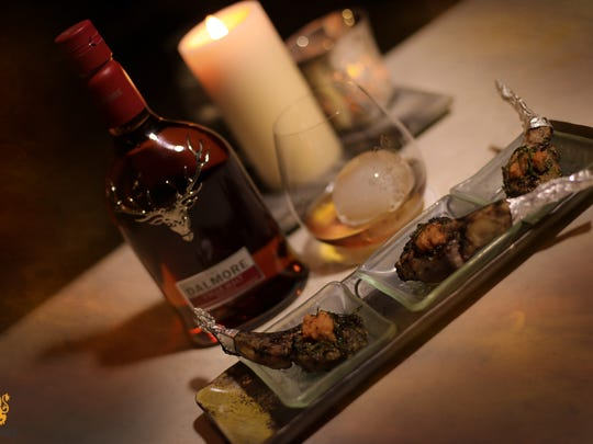 Delicious cuisine created by Duke Estime, executive chef, Le Malt Lounge, and a bottle of Dalmore's Cigar Malt, one of the top-shelf brown spirits offered at Le Malt