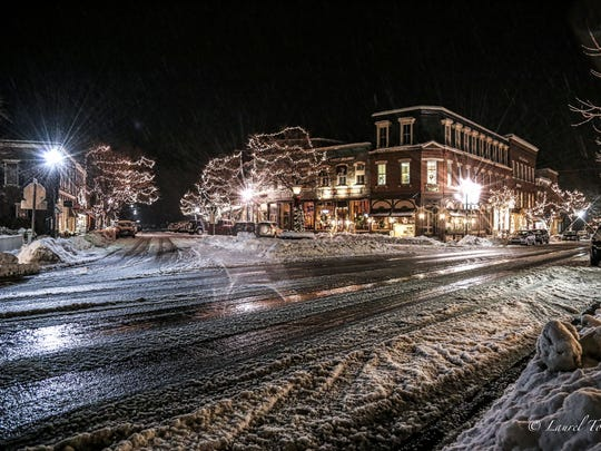 The village of Woodstock at night.