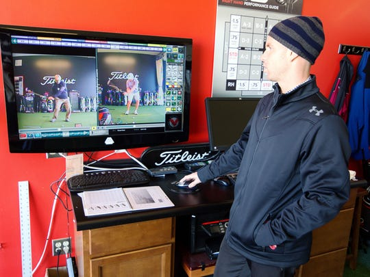 Assistant golf pro Cole Peevlar demonstrates swing analysis technology at the Performance Studio at Blue Top Ridge Golf Course at Riverside Casino and Golf Resort.