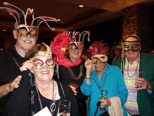 Guests behind the masks are from left: Gary Methner, Lola Methner, Tom Lewis, Joan Clark and Bob Clark.