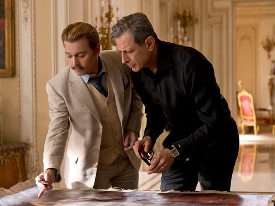 "Johnny Depp (left) and Jeff Goldblum appear in ""Mortdecai."""
