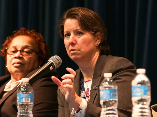 Robin Aube-Warren (right), director of the Wilmington VA Medical Center, addresses the media and veterans during a town hall meeting Feb. 19 in Wilmington.