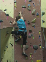 Diana Lusk, climbs a wall during an open night at the Elite Climbing, LLC in Maple Shade.