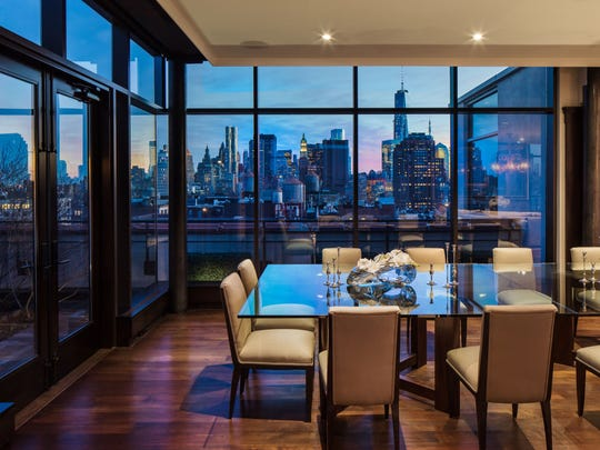 Jon Bon Jovi's five-bedroom penthouse has glass windows overlooking Manhattan and two gourmet kitchens.