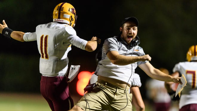 Mountain Pointe's Nick Wallerstedt (#11) celebrates his touchdown against Chandler in the first quarter of their high school football game on Friday, Sept. 8, 2017, at Chandler High School in Chandler, Ariz.
