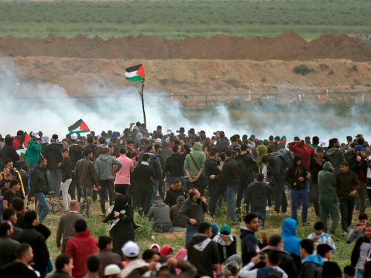 Palestinians take part in a demonstration on March 30, 2018, commemorating Land Day near the border with Israel east of Gaza City.