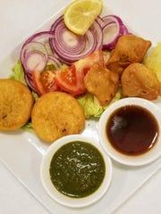 Samosas and Aloo Tiki with mint and tamarind sauce.