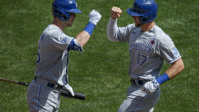 Kansas City Royals' Hunter Dozier (17) celebrates with Ryan O'Hearn (66) his solo home run against the Minnesota Twins in the first inning Sunday, in Minneapolis.