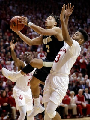 Purdue's Carsen Edwards (3) shoots against Indiana's Juwan Morgan during the first half of an NCAA college basketball game, Sunday, Jan. 28, 2018, in Bloomington, Ind.