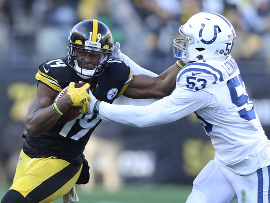 Nov 3, 2019; Pittsburgh, PA, USA;  Pittsburgh Steelers wide receiver JuJu Smith-Schuster (19) runs after a catch against Indianapolis Colts outside linebacker Darius Leonard (53) during the third quarter at Heinz Field. Pittsburgh won 26-24. Mandatory Credit: Charles LeClaire-USA TODAY Sports