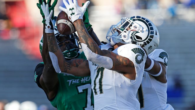 Colorado State safety Jordan Fogal (11) intercepts a pass intended for Marshall wide receiver Obi Obialo (7) during the first half of the New Mexico Bowl NCAA college football game in Albuquerque, N.M., Saturday, Dec. 16, 2017. (AP Photo/Andres Leighton)
