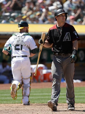 Arizona Diamondbacks' Paul Goldschmidt, right, walks to the dugout after striking out against the Oakland Athletics during the eighth inning of a baseball game in Oakland, Calif., Sunday, May 27, 2018.
