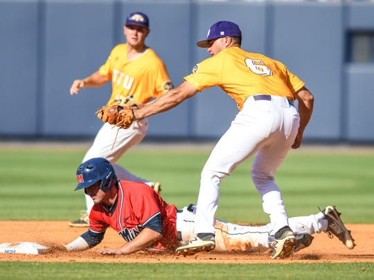Mississippi's Nick Fortes, front left, is caught stealing by Tennessee Tech infielder David Garza (6) in the NCAA college baseball Oxford Regional in Oxford, Miss., Sunday, June 3, 2018. (Bruce Newman/The Oxford Eagle via AP)