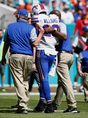 Buffalo Bills strong safety Aaron Williams is helped
