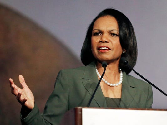 FILE - In this March 15, 2014, file photo, former Secretary of State Condoleezza Rice gestures while speaking before the California Republican Party 2014 Spring Convention in Burlingame, Calif. More than two dozen universities with major basketball programs _ including Louisville, where Hall of Fame coach Rick Pitino is in the process of being fired after 16 seasons _ have responded to news of the sport's bribery scandal by conducting internal reviews of their compliance operations.  The NCAA formed a fact-finding commission to be led by former Secretary of State Condoleezza Rice, with results expected in April. (AP Photo/Ben Margot, File)