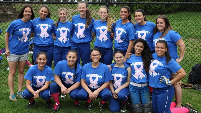 The Dobbs Ferry softball team poses for a photo before the Ardsley Rivertowns softball tournament May 9, 2015.  They were playing the games as a fundraiser for breast cancer awareness.