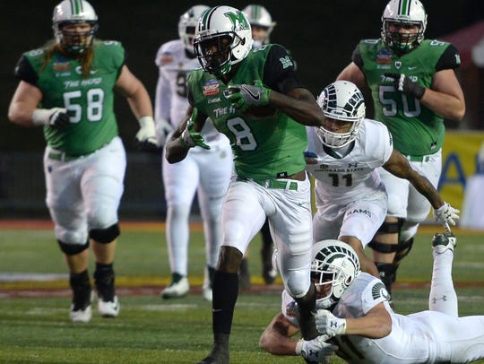 Marshall wide receiver Tyre Brady runs after making