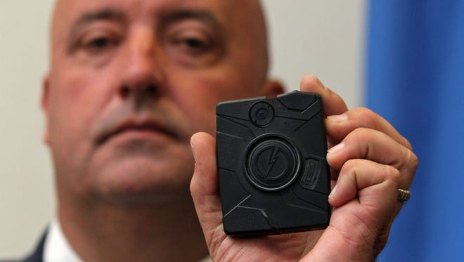 Thomas Koundry of the Union County Prosecutor's Office displays the Taser Axon Body Camera.