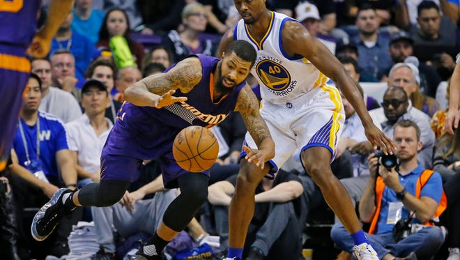 Suns forward Markieff Morris goes for a loose the ball against Golden State on Feb. 10,  2016 in Phoenix.