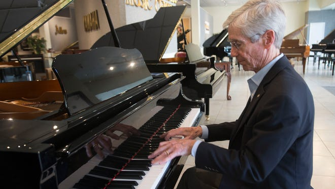 Bill Dollarhide, right, and his wife, Margaret are planning to close their music store at the end of May and begin retirement. Dollarhide's Music Center has been a fixture in downtown Pensacola since the piano retailer open on Palafox Street in 1988.