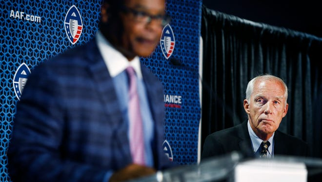Alliance of American Football league J.K.McKay (right) Head of Football Operations looks as Mike Singletary as the Memphis teams new head coach during a press conference at the Liberty Bowl Memorial Stadium.