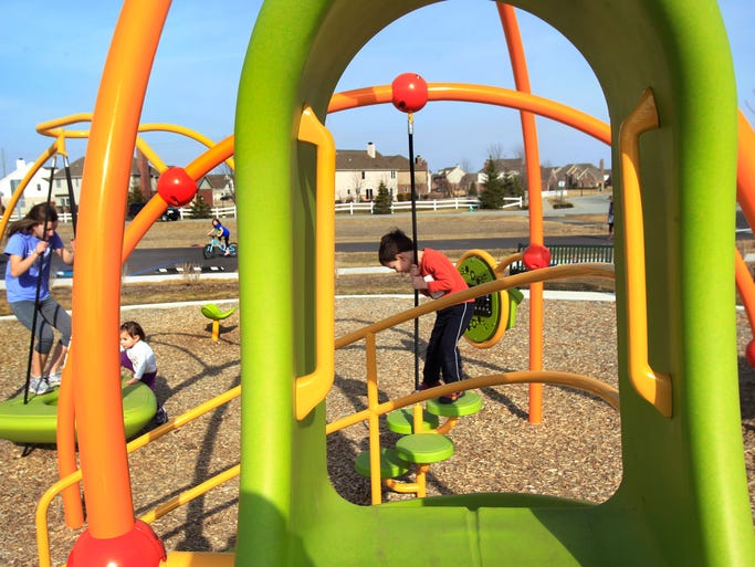 Children enjoy the new Heritage Trail Park at 4050 S 875 East in Zionsville  Friday, March 21, 2014. It is the town's fourth park to open since 2008.