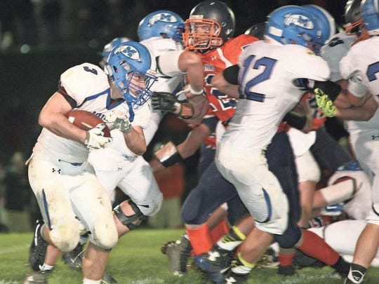 Montezuma's Carson Losure bulls his way through the line as he gains extra yards at Colfax-Mingo. Losure finished the game with 196 yards on 37 carries and one fumble recovery.