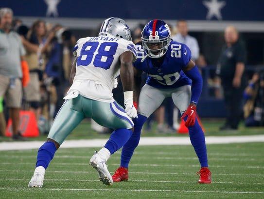 The Giants' Janoris Jenkins checks the Cowboys' Dez